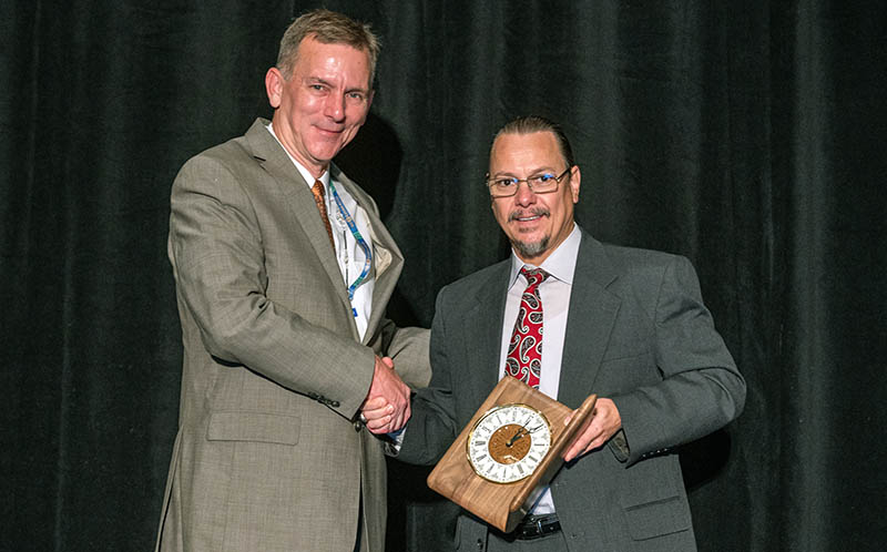 Erik Loehr reeives the Osterberg Award
